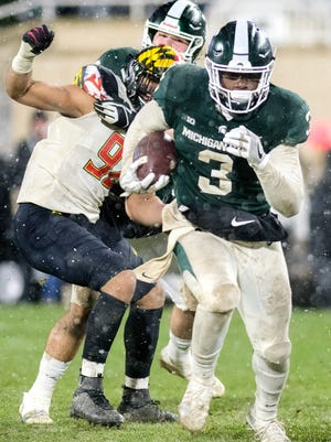Michigan State's LJ Scott runs for a gain during the fourth quarter on Saturday, November 18, 2017, at Spartan Stadium in East Lansing.
