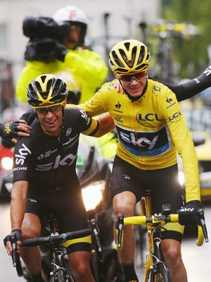 Chris Froome, right, rides with Sky teammate Richie Porte on Sunday.