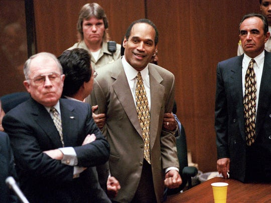 "In this Oct. 3, 1995 file photo, O.J. Simpson, center, clenches his fists in victory after the jury said he was not guilty in the murders of his ex-wife Nicole Brown Simpson and her friend Ronald Goldman in a Los Angeles courtroom as attorneys F. Lee Bailey, left, and Robert Shapiro, right, look on. FX is joining with ""American Horror Story"" producer Ryan Murphy on a true-crime anthology miniseries. The new miniseries, ""American Crime Story,"" will focus each season on a different crime that captured the public's imagination, FX said Tuesday, Oct. 7, 2014. The 1994 murder of Simpson's ex-wife, Nicole Brown Simpson, and Ronald Goldman, and Simpson's arrest and trial led to a prolonged media frenzy. The former NFL hall of famer and former TV and movie star was acquitted in the case but is in prison for a hotel robbery."