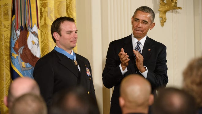 President Obama presents the Medal of Honor to Senior Chief Special Warfare Operator Edward Byers, U.S. Navy.  Byers, a 36-year-old member of SEAL Team Six, was part of an elite special forces operation that rescued an American doctor who had been kidnapped for ransom by Taliban fighters in Afghanistan while trying to establish medical clinics in the war-torn country.