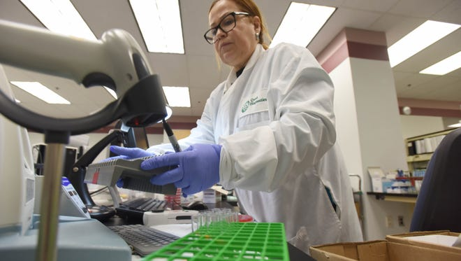 Martha Paez prepare testing for bacterial identification. Quest Diagnostics, a large local employer (2,300 NJ employees) who reach thousands of local residents every day through medical testing, celebrate their 50th Anniversary.
