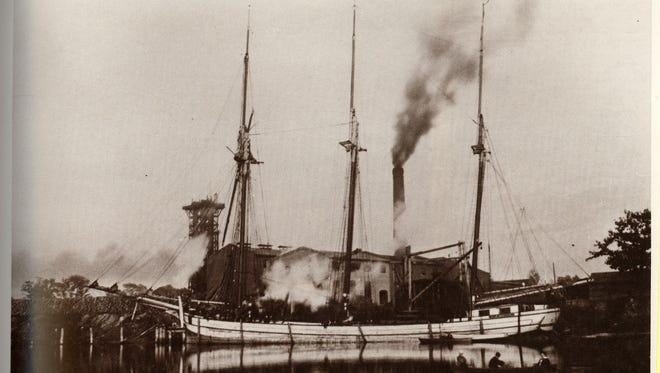 The Michigan Sulphite Fibre Co. began manufacturing paper on the Black River in 1889. This photograph, taken around 1890, shows the schooner G.T. Boyce unloading pulp at the company's dock.