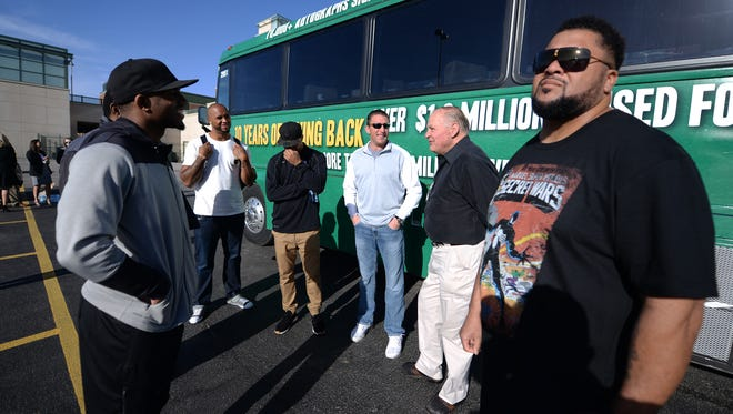 The Green Bay Packers Tailgate Tour hit the road Tuesday, April 9, 2015 for their 10th anniversary road trip April 14-18. Gilbert Brown, right, soaks in the morning sunshine with the group before the he boarded the bus.