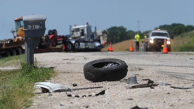 Debris from a three-vehicle collision litter Highway 23 between Poplar and Tower roads. The July 15 crash involved two passenger cars and a flatbed semi.