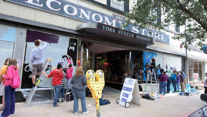 In this file photo, Dallastown High School students paint a storefront at The York Rescue Mission Economy Store on West Market Street Tuesday, Oct. 13, 2015.