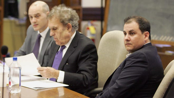 Defendant Alexander Fazzino, right, waits with his attorneys William Kutmus, center, and Trever Hook ahead of jury selection process for Fazzino's trail Monday, Feb. 22, 2016, in Winneshiek County District Court in Decorah, Iowa. Court officials and attorneys began selecting from a large pool of potential jurors Monday for the high-profile trial of Fazzino who is charged with killing his wife.