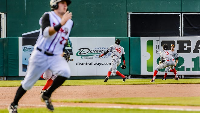 Connor Panas, left, of the Lugnuts speeds toward home as Brendon Davis, 3, of the Loons moves to control a hit by Jake Thomas of the Lugnuts in the bottom of the 5th inning of their game Wednesday June 15, 2016 at Cooley Law School Stadium in Lansing. Panas recently revealed that his off-the-field talent is opera singing.