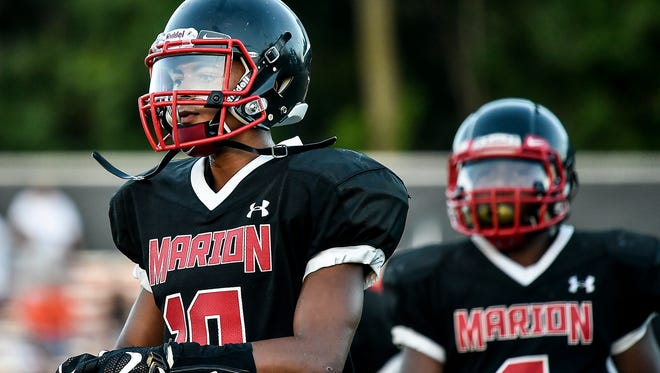 Marion Harding's Nick Middlesworth (left) and Tyriq Harris take to the field during the Harding-Mount Vernon game Friday night at Harding Stadium. The Presidents have their toughest test of the season Friday when they host Lima Senior.