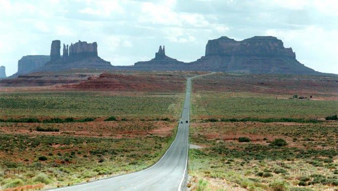Highway 163 snakes through Monument Valley on the Navajo Reservation. Highway 163 snakes through Monument Valley on the Navajo Reservation.