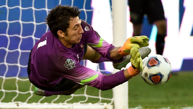 Stanford goalkeeper Andrew Epstein blocks the penalty kick of Wake Forest midfielder Brad Dunwell to win the men's soccer national title on Sunday. Epstein is a graduate of Poudre High School.