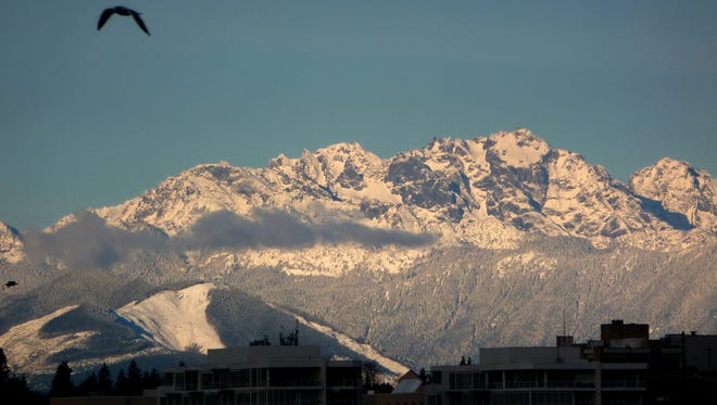 Snow covers the Olympic Mountains from the the Bremerton to Seattle ferry.