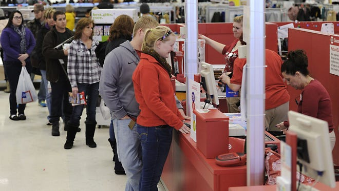 Christopher Millette/Erie Times-News via AP People return items at Target in Summit Township, Pa., the day after Christmas 2013. Prepare yourself for gifts that miss the mark by learning the ins and outs of retail return policies. FILE - In this Dec. 26, 2013, file photo, Ally Belden, center, returns an item at Target in Summit Township, Pa. After a busy shopping season, holiday returns inevitably come next. Prepare yourself for gifts that miss the mark by learning the ins and outs of retail return policies. (Christopher Millette/Erie Times-News via AP, File)