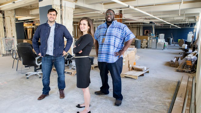 Robert Herrera (left), president and founder of The Mill, poses for a portrait with Zip Code's Head of School Melanie Augustine and Director of Education Tariq Hook in the unfinished office space Zip Code will take over at The Mill in Wilmington.