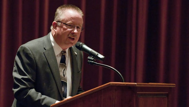 In this 2012 file photo, Indiana High School Athletic Association Commissioner  Bobby Cox speaks to a crowd during a town hall meeting  at  Plainfield High School.