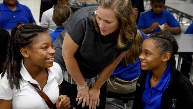 Northeast Middle School teacher Mandy Fraley talks with two NEMS sixth graders, Makya Smith and Brooklein Crawford, Thursday afternoon at their school. Fraley is a finalst for the Tennessee Department of Education's Teacher of the Year.