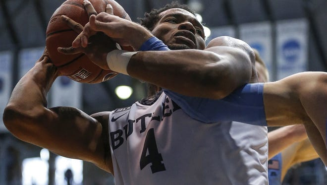 Powerful Butler forward Tyler Wideman has been a steady presence for the Bulldogs.  Wideman (4) fought with Marquette Golden Eagles guard Andrew Rowsey for a rebound in the second half at Hinkle Fieldhouse on  Jan. 16, 2017.