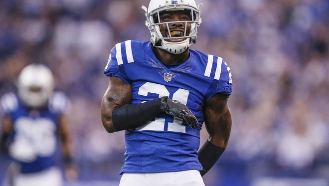 Indianapolis Colts cornerback Vontae Davis (21) celebrates after knocking down a pass meant for Tennessee Titans wide receiver Kendall Wright (13) in the first half at Lucas Oil Stadium on Sunday, Nov. 20, 2016.
