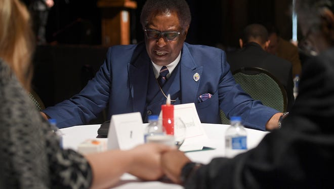 Light of Light Ministries Bishop Nathaniel Bond leads a prayer at his table for law enforcement, military, first responders, and fire fighters during the mayor's prayer breakfast in conjunction with 2018 National Day of Prayer, Thursday, May 3.