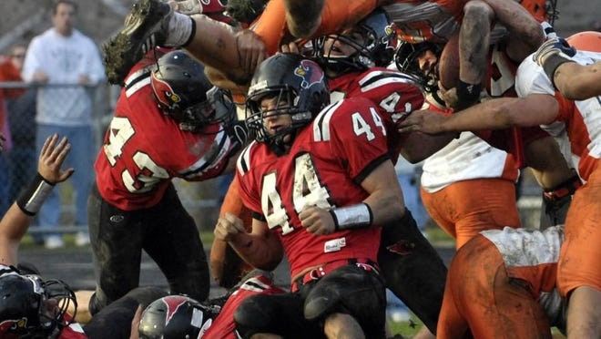 A mess of Metamora defenders stop Rochester quarterback Sean Robinson from scoring the game-winning two-point conversion in a 2009 Class 4A state semifinal game at Malone Field in Metamora.
