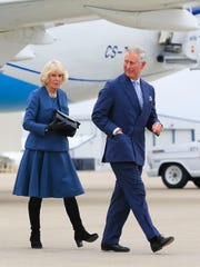Prince Charles and Duchess Camilla walk towards their motorcade after arriving at Louisville International Airport Friday afternoon. By Matt Stone, The Courier-Journal March 20, 2015
