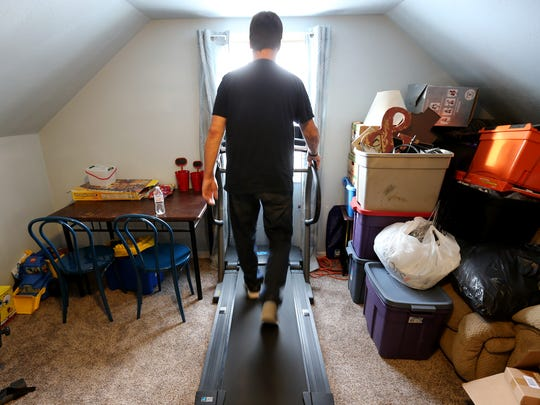 Heart transplant recipient Bruce Nechodom walks on a treadmill home on Wednesday, December 28, 2016 in Darboy, Wis.
