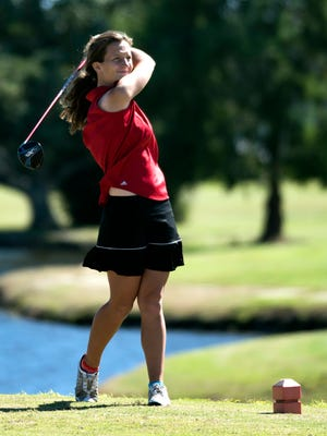 Pace High School's Elise Schultz watches her shot from the 18th tee during the girls 1-2A regional golf tournament Tuesday at Tiger Point Golf Club in Gulf Breeze.