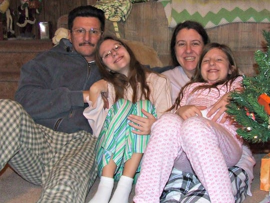 Carmen (left) with daughter Gianna, wife Crystal and daughter Toni during their last Christmas together in 2010.