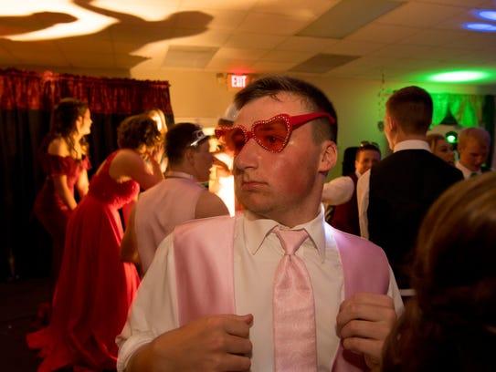Blake Schmitt, 15, sports some heart shades during