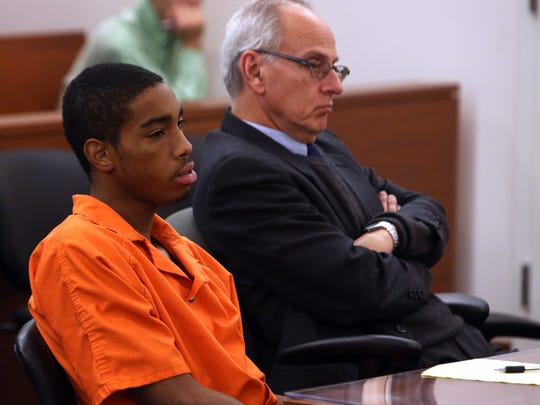 Joei Jordan, 20 and his lawyer David Goldstein sit and listen to testimony in their preliminary hearing in front of Judge Joseph Burke at his courtroom at 15th District Court in Ann Arbor. Michigan on Friday, Dec. 13, 2013.