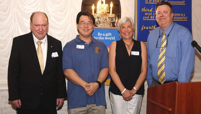 (From left) New Rotarians Steve Plevins, Dong Choo and Susan Sauro with Rotary Club of Vineland President Wayne Triantos.