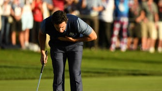 Rory McIlroy reacts after winning his match in the afternoon four-ball matches during the 41st Ryder Cup at Hazeltine National Golf Club.