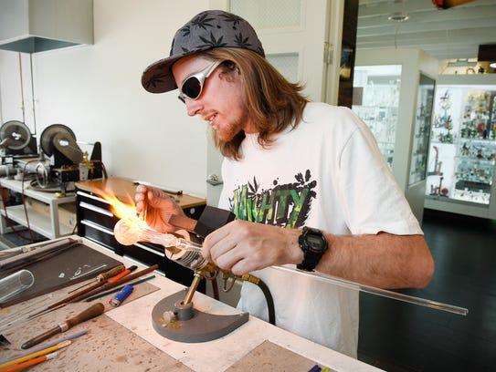 Glass artist Andrew Zackoski, Melrose, demonstrated