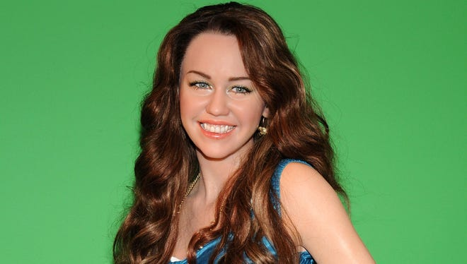 A wax figure of singer/actress Miley Cyrus appears on display during its unveiling at Madame Tussauds March 20, 2008 in New York City.