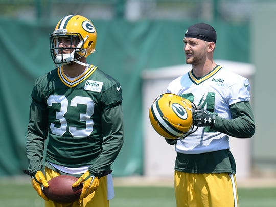 Packers receiver Jared Abbrederis (84) stands with defensive back Micah Hyde (33) during organized team activities Thursday at Clarke Hinkle Field.
