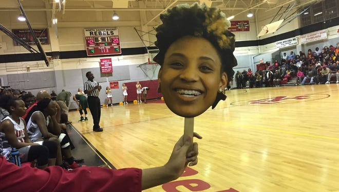 Lifesized cut out head shots of North Caddo's Destiny Rice were spread throughout the stands Thursday night.