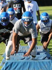 Bremerton's McCoy Retome leads his teammates in a drill
