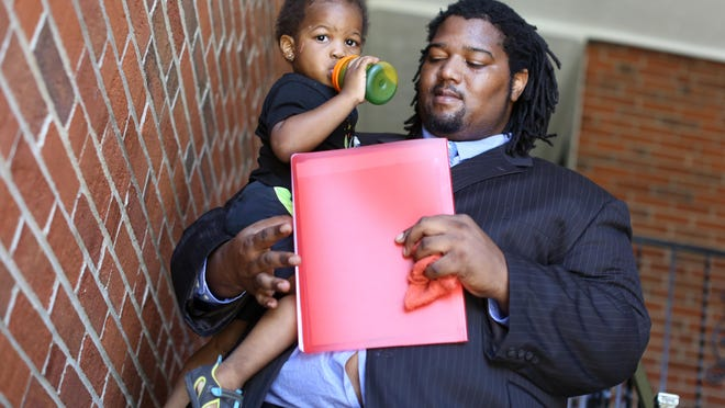 Eric Powell Jr, 24, of Madisonville, takes his son, Xavier, 2, with him to drop a resume off at Speedway. Xavier waited in the car with a friend. Powell recently finished an Urban League jobs program.