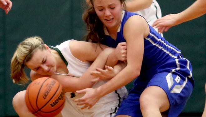 Salem Academy's Lindsey Larsen (15), left, and Blanchet's Sophia Poole (15) fight for the ball on the floor in the Blanchet vs. Salem Academy girl's basketball game at Salem Academy High School on Thursday, Jan. 14, 2015.