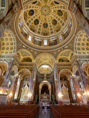 "An interior view of the St. Josaphat Basilica.  Crews with Masonry Restoration Inc., out of Milwaukee, work on positioning a 5,500 pound piece of Scioto sandstone, from an Ohio quarry, to a corner of the St. Josaphat Basilica at 601 W. Lincoln Avenue in Milwaukee on Monday, August 22, 2016. The work was part of the first phase of its current restoration project at The Basilica of St. Josaphat and included replacement of five large stones that were lifted and hoisted into the air by crane to replace some of the damaged sandstone. These replacement stones are a portion of the first ""emergency phase"" of the Basilica Foundation's current capital campaign to raise $7.5 million for restoration of the Basilica. The local Landmark is looking for the Milwaukee community's support to complete its fundraising campaign and finish the critical restorations."