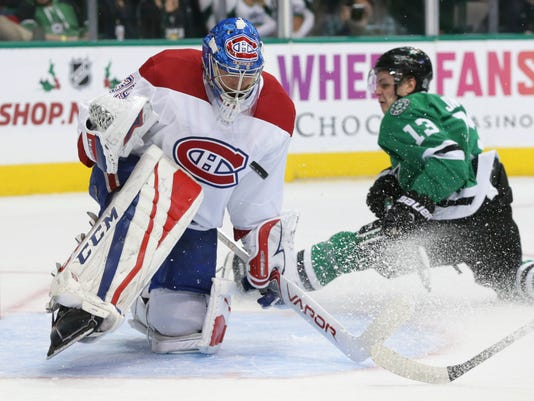 Montreal Canadiens goalie Charlie Lindgren (39) blocks a shot against Dallas Stars center Mattias Janmark (13) during the first period of an NHL hockey game in Dallas, Tuesday, Nov. 21, 2017. (AP Photo/LM Otero)