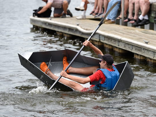 Troy Julian, 13, of Georgetown goes down with his boat at the Second Annual Recycled Cardboard Boat Regatta in Blades. Sponsored by DNREC, the regatta is a chance to show the world how long you can make a cardboard boat float in the mighty Nanticoke River.