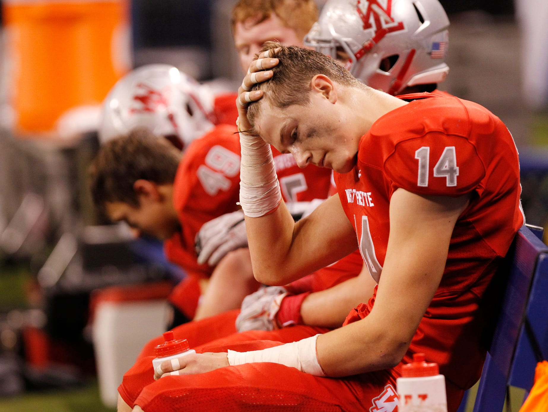 West Lafayette's Frank Bodi rubs his head as the clock winds down against Bishop Chatard in the Class 3A state finals Friday, November 27, 2015, at Lucas Oil Stadium in Indianapolis. West Lafayette fell to Bishop Chatard 31-7.