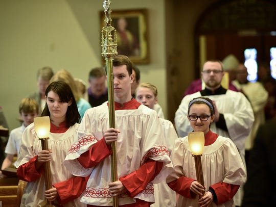 The walk to the alter starts Mass Tuesday, March 1,