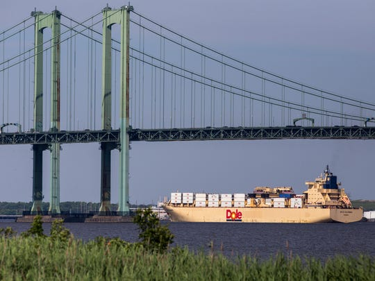 "Compact Membrane Systems in Newport recently introduced a new product that will filter water out of ""environmentally acceptable lubricants"" used in large ships like the Dole Colombia, seen here making its way up the Delaware River toward the Delaware Memorial Bridge and Port of Wilmington."