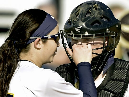 Greencastle pitcher Ally Brown playfully grabs catcher Mac Oberholzer's face mask during a meeting on the mound earlier this season. Brown is expected to start in Monday's first-round PIAA Class AAA game against Abington Heights.