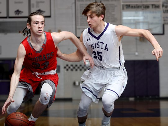 Foothill's Brandon Gentles, left, takes the ball past Shasta's Conner Coughren in the Cougars' 68-48 win.