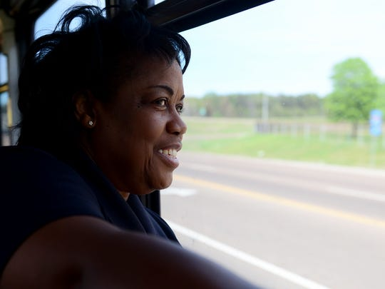 Tennessee Highway Safety Office Assistant Law Enforcement Adminstrator Brenda Jones looks out of the window of a Tennessee Highway Patrol bus to look for motorist who are engaged in distracted driving, Monday, April 10, in Jackson during Tennessee's first statewide distracted driving enforcement bus tour.