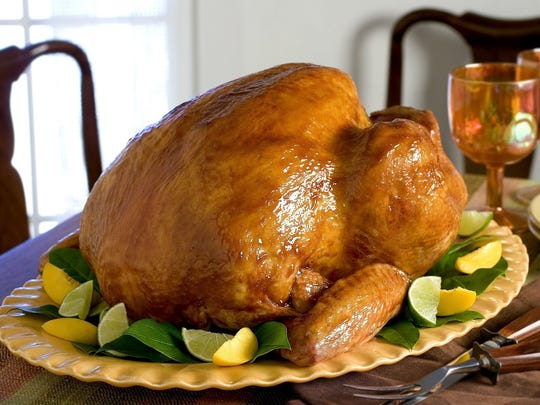 -  -** FOR USE WITH AP WEEKLY FEATURES** This photo provided by Butterball shows Glazed Turkey, a fine roast for the Thanksgiving table centerpiece. The glaze gives the skin a golden glow that's both great to look at and to taste, with its intriguing combination of ingredients that include sweet barbecue sauce, coffee and cumin. (AP Photo/Butterball)