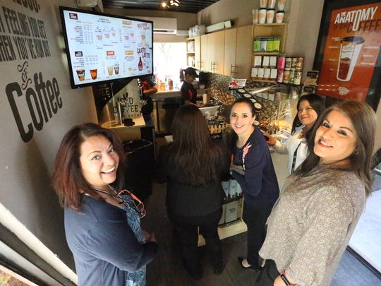 Employees from nearby Workforce Solutions crowd around the counter at Coffee Box at 410 N. Mesa in downtown El Paso.