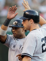 Robinson Cano, left, and Mark Teixeira were teammates on the New York Yankees from 2009-2013.